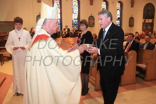 Bishop Malooly receives the gifts during St. Helena Church 75th Anniversary Mass, Saturday, November 5, 2011. photo/Don Blake Photography