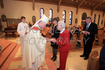 Bishop Malooly receives the gifts during St. Helena Church 75th Anniversary Mass, Saturday, November 5, 2011. photo/Don Blake Photography