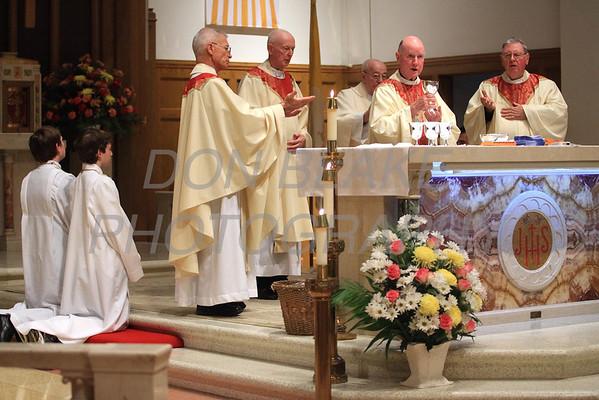 Bishop Malooly bless the gifts during St. Helena Church 75th Anniversary Mass, Saturday, November 5, 2011. photo/Don Blake Photography