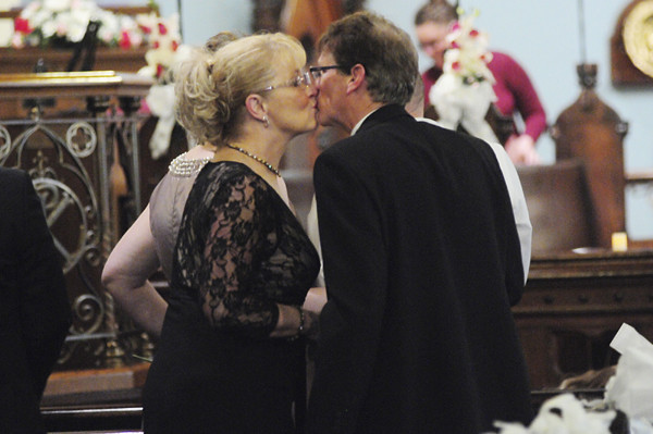 Dan and Jane Cullen of Pulaski seal their vows with a kiss. — Tiffany Wolfe