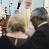 The Rev. Dennis Blauser performs the  vow renewal ceremony. — Tiffany Wolfe