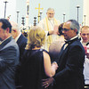Tiffany Wolfe/NEWS<br /> Father Dennis Blauser performs a vow renewal ceremony over 14 couples Saturday evening at St. Jude Episcopal Church in New Castle.
