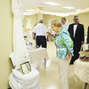 Lin Reed of Neshannock Township looks at one of the vintage wedding dresses of a church member that was hanging around the reception hall of the church after the service. — Tiffany Wolfe
