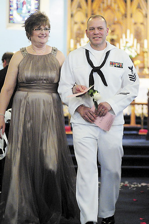 Tiffany Wolfe/NEWS<br /> Valerie and Dean Custozzo of Ellwood City walk down the aisle after a vow renewal ceremony involving 14 couples Saturday at St. Jude Episcopal Church.