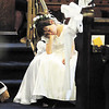 Tiffany Wolfe/NEWS<br /> Ellie Cullen, 6, of Pulaksi, who was a flower girl for her grandparents who were renewing their vows, takes a break in the middle of the service.