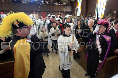 Fr. Michael Darcy processes with the cross during mass celebrating St. Mary of the Assumption's 240 years. photo/ www.DonBlakePhotography.com