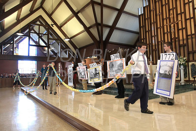 Children display a prayer chain and pictures of the church buildings that span St. Mary of the Assumption's 240 years before mass celebrating St. Mary of the Assumption anniversary. photo/ www.DonBlakePhotography.com