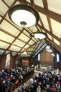 Parishioners pray during mass celebrating St. Mary of the Assumption's 240 years. photo/ www.DonBlakePhotography.com