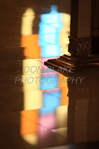 The colorful stained glass shines off the alter during mass celebrating St. Mary of the Assumption's 240 years. photo/ www.DonBlakePhotography.com