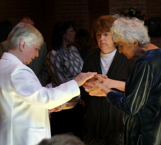 Associates of the Dominican Sisters receive communion. St. Mary of the Springs Columbus, OH 4/18/2010
