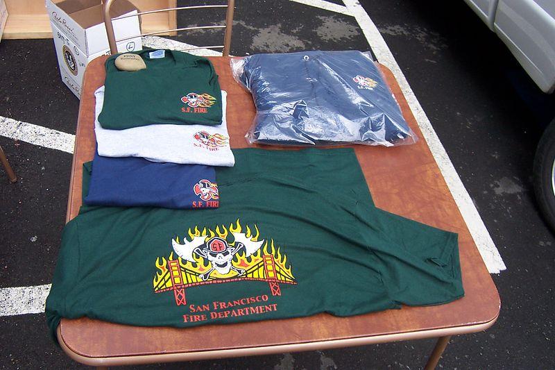 BarbaryCoast Shirts and Hats at outdoor table