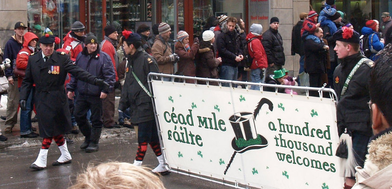 Note the young Vietnamese boy on the left marching with Gaelic greeting banner. I don't know if the St.Jean Baptiste Society would totally approve of their bilingual sign, even if the English part is smaller!