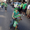 Record-Eagle/Keith King<br /> Katie Williams, 12, of Traverse City, rides her bicycle along Front Street Saturday, March 17, 2012 during the annual St. Patrick's Day Parade in downtown Traverse City. Williams' mother, Molly Williams, was the 33rd Irish Queen for the parade and her grandmother, Dottie Bridges, was the 10th Irish Queen for the parade.