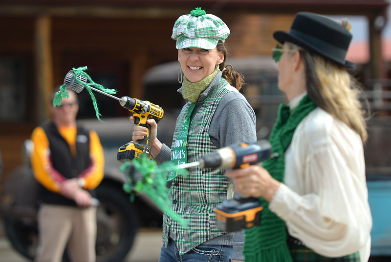 "Justin Sheely | The Sheridan Press<br /> Ryan Sanke, left, marches with Kate Sheehan during the annual St. Patrick's Day parade in Big Horn Saturday, March 17, 2018. Residents of the unincorporated town of Big Horn take pride in their impromptu ""shortest parade in the world"" every St. Patrick's Day."