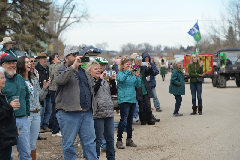 "Justin Sheely | The Sheridan Press<br /> People watch the annual St. Patrick's Day parade in Big Horn Saturday, March 17, 2018. Residents of the unincorporated town of Big Horn take pride in their impromptu ""shortest parade in the world"" every St. Patrick's Day."