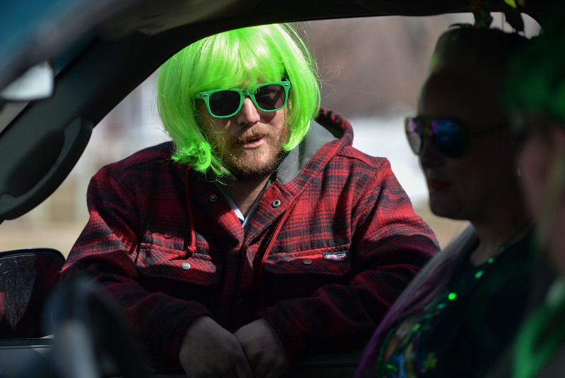 "Justin Sheely | The Sheridan Press<br /> Jacob Townsend visits during the annual St. Patrick's Day parade in Big Horn Saturday, March 17, 2018. Residents of the unincorporated town of Big Horn take pride in their impromptu ""shortest parade in the world"" every St. Patrick's Day."