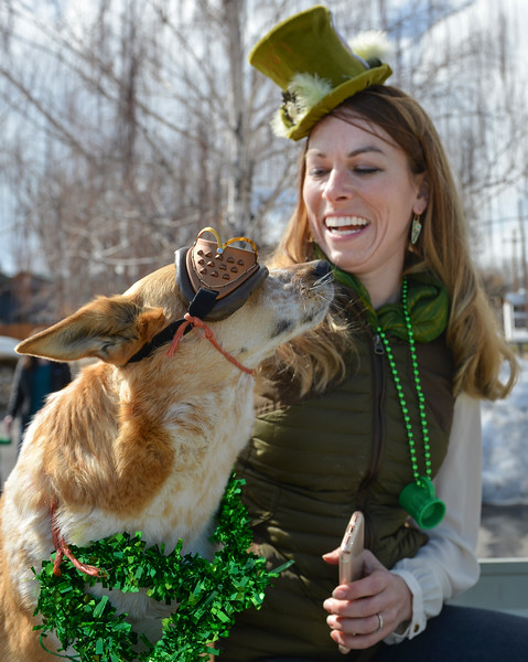 "Justin Sheely | The Sheridan Press<br /> Candace Swanson enjoys her dog Francis in the back of a float during the annual St. Patrick's Day parade in Big Horn Saturday, March 17, 2018. Residents of the unincorporated town of Big Horn take pride in their impromptu ""shortest parade in the world"" every St. Patrick's Day."