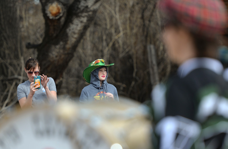 "Justin Sheely | The Sheridan Press<br /> Kayla Graves, left, and daughter Morgan Graves, 11, watch the annual St. Patrick's Day parade in Big Horn Saturday, March 17, 2018. Residents of the unincorporated town of Big Horn take pride in their impromptu ""shortest parade in the world"" every St. Patrick's Day."