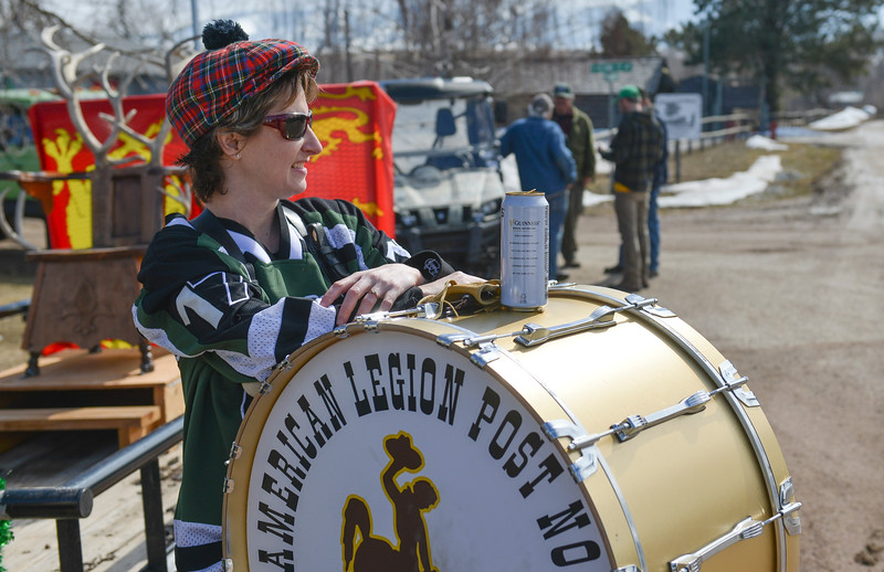 "Justin Sheely | The Sheridan Press<br /> Miranda Connell waits with her drum during the annual St. Patrick's Day parade in Big Horn Saturday, March 17, 2018. Residents of the unincorporated town of Big Horn take pride in their impromptu ""shortest parade in the world"" every St. Patrick's Day."