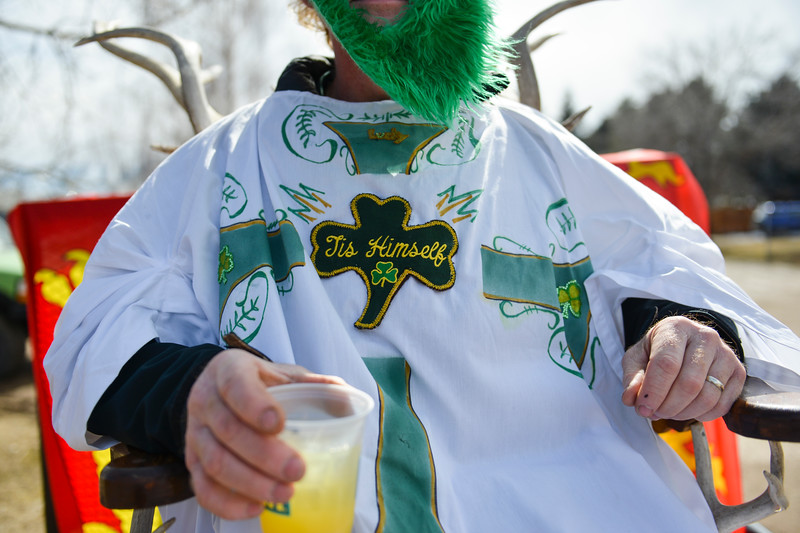 "Justin Sheely | The Sheridan Press<br /> Tad Chenoweth, as St. Patrick, enjoys a drink during the annual St. Patrick's Day parade in Big Horn Saturday, March 17, 2018. Residents of the unincorporated town of Big Horn take pride in their impromptu ""shortest parade in the world"" every St. Patrick's Day."