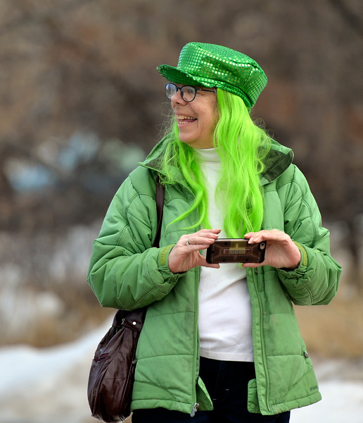 "Justin Sheely | The Sheridan Press<br /> Susie Cannon snaps pictures of the annual St. Patrick's Day parade in Big Horn Saturday, March 17, 2018. Residents of the unincorporated town of Big Horn take pride in their impromptu ""shortest parade in the world"" every St. Patrick's Day."