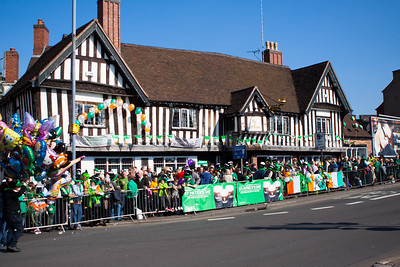 Crowds gather outside The Old Crown Pub on the parade route