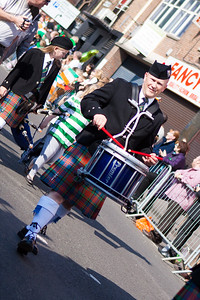 Drummer in action during the Birmingham St. Patricks Festival Parade