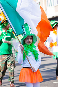 Flag wavng during the Birmingham St. Patricks Festival Parade