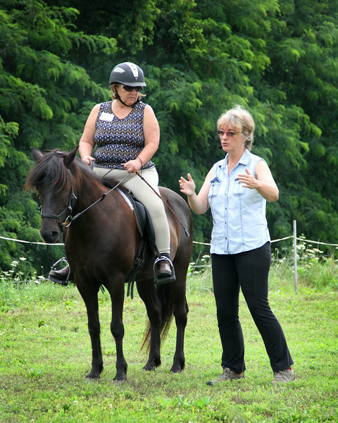 Jacki Edens riding Svort from Curtis being instructed by Barbara Frische