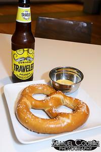 A Curious Traveler and a pretzel.