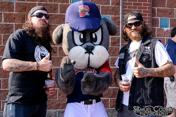 Guys from the Maine Facial Hair Club posing with Slugger.