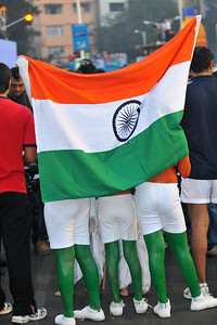 Children with Indian flag at the Standard Chartered Mumbai Marathon 2010. Mumbai, India. January 17, 2010.