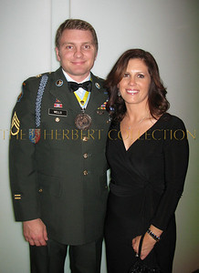 "Staff Sgt. Brian Wells wearing ""Medal of the Order of St. Maurice"" with wife Michelle"