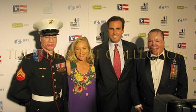 Marine Cpl. Aaron Mankin, Lee and Bob Woodruff with Marine Sgt. Merlin German (Merlins Miracle's)