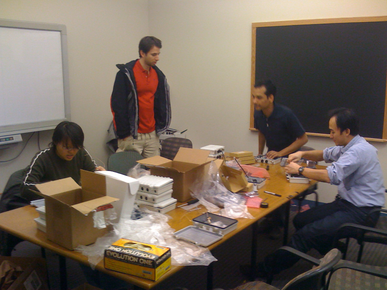 The Stanford Experimental Wifi deployment team at work putting together 90 access points.