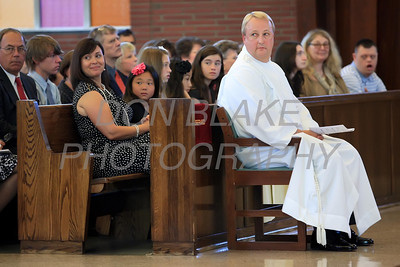 Michael Stankewicz sit in front of his family during the Ordination of Deacon at St. Mary of the Assumption, Saturday, September 15, 2012. www.DonBlakePhotography.com