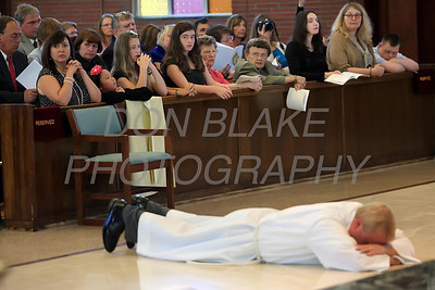 Michael Stankewicz prostrates him self as Bishop Malooly and all in attendance pray during the Ordination of Deacon at St. Mary of the Assumption, Saturday, September 15, 2012. www.DonBlakePhotography.com