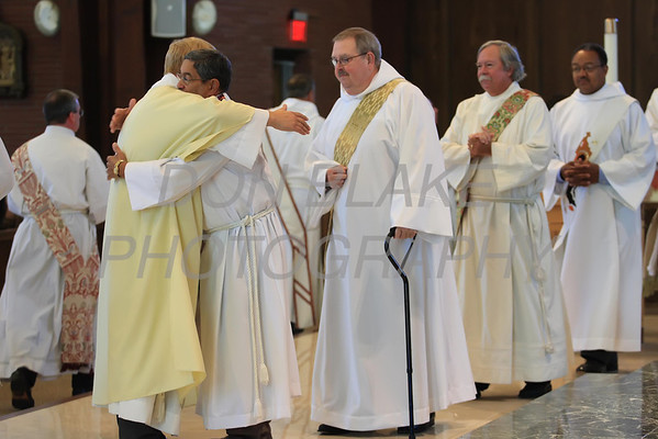 Michael Stankewicz receives the kiss of peace from fellow Deacons during the Ordination of Deacon at St. Mary of the Assumption, Saturday, September 15, 2012. www.DonBlakePhotography.com