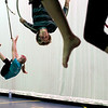 Record-Eagle/Jan-Michael Stump<br /> From left, Jen Keyser, Cody Davis and Katie Athanson practice for their upcoming Starfish Circus performance Tuesday in the auditorium at Traverse City West High School.