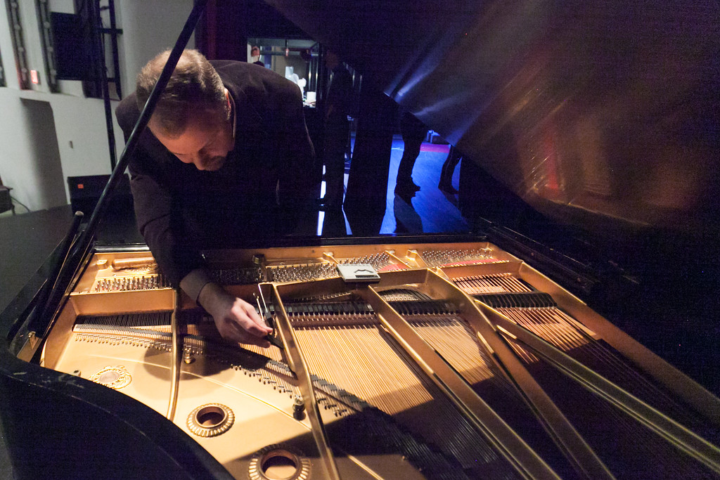 Tibby McDowell | The Sheridan Press<br /> Sam Hoffmann adjusts the D key on the piano before performances start for Stars of Tomorrow at the WYO Performing Arts and Education Center Friday Feb. 23, 2018.