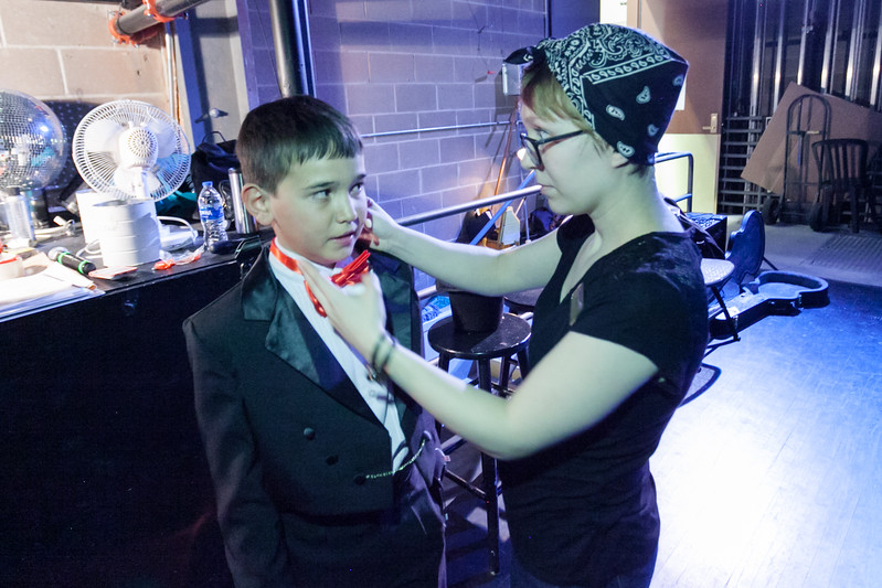 Tibby McDowell | The Sheridan Press<br /> Mona Garber, right, fits Jory Githens with a head mic prior to his performance in Stars of Tomorrow at the WYO Performing Arts and Education Center Friday Feb. 23, 2018.