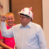 Dale Grant, Chadron State College vice president for administration and finance, pumps his arm after being presented a hard hat by CSC student Luke Wright of Hamlet during the fall semester's first meeting of the faculty and staff Aug. 17. The helmet, which is decorated in the spirit of the students' Find the Flamingo game, is intended to prepare Grant for the challenges ahead as the institution plans to begin three large facility construction projects that total about $19 million. (Photo by Justin Haag)