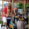 Eve and Grannie enjoying their Carousel ride