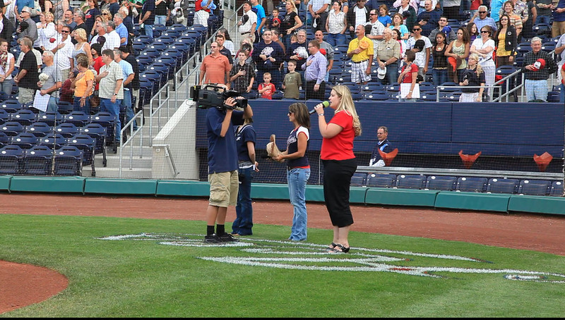 Holly Hill Johnson, State Farm Agent, singing our National Anthem.