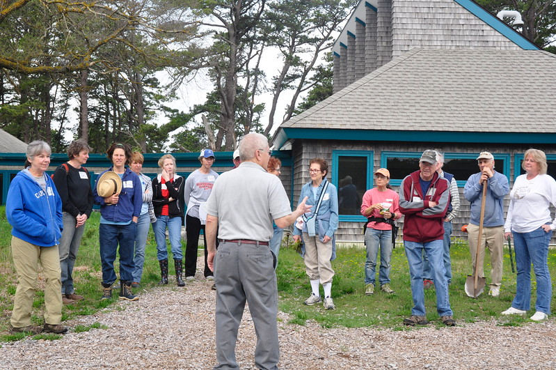 Volunteers gather for a welcome and an orientation to the morning's tasks.