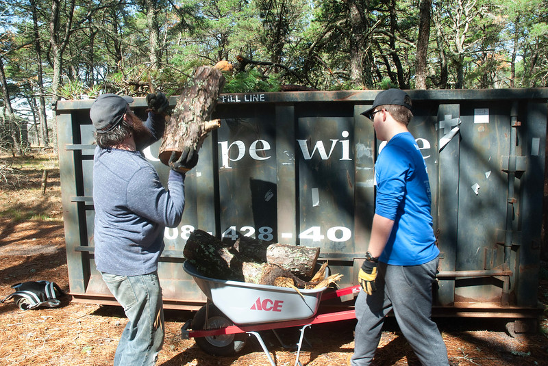 In all, volunteers clear 20 truck loads of fallen trees and other winter debris.
