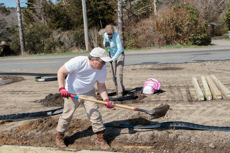 At Tidmarsh, Mass Audubon's newest wildlife sanctuary, volunteers install 350 feet of curbing on the expanded parking lot.