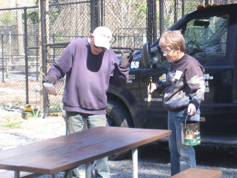 People painted 6 picnic tables and built 9 more.
