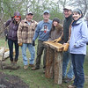 A group of resourceful volunteers recycled fallen locust trees into 3 sturdy benches.