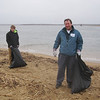 cleaning up 3 acres of beach and dunes.